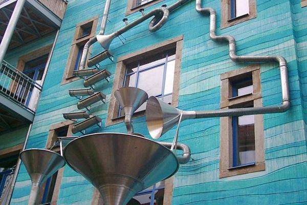 unique trumpet-style commercial property gutter system