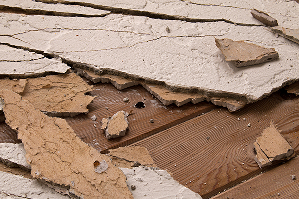Pieces of broken stucco caused by water damage.