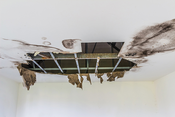 A big hole on the ceiling caused by leakage from the roof.