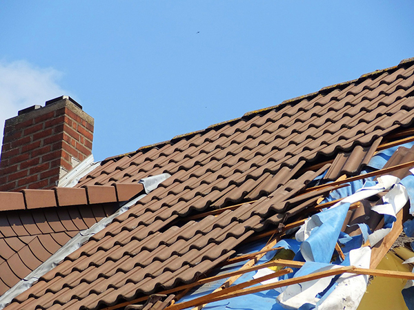 A severely damaged roof that needs to be replaced.