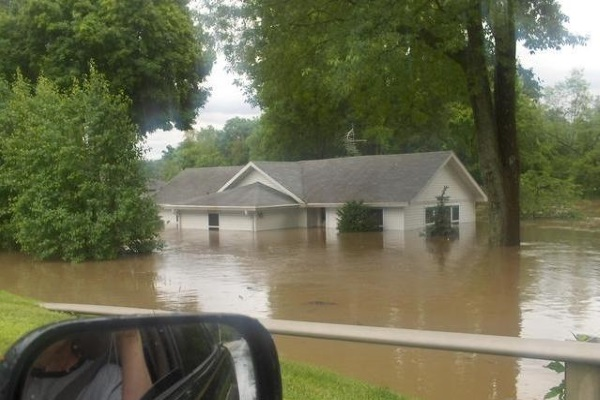 property flooded from ground to halfway the first floor
