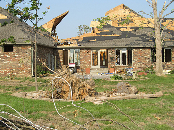 An aftermath of a terrible tornado damaging the roof completely.