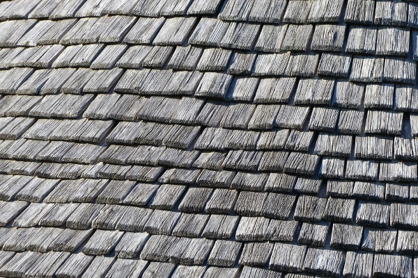 wood-textured metal shingles on a shed roof