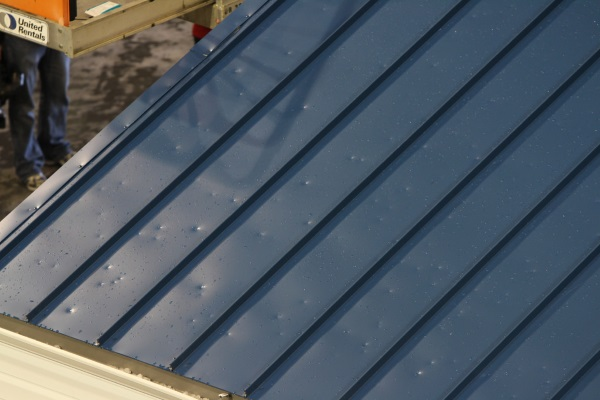 metal roofs dented by golfball-sized hailstones