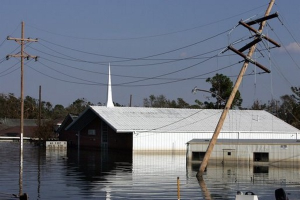 a property submerged to the roof