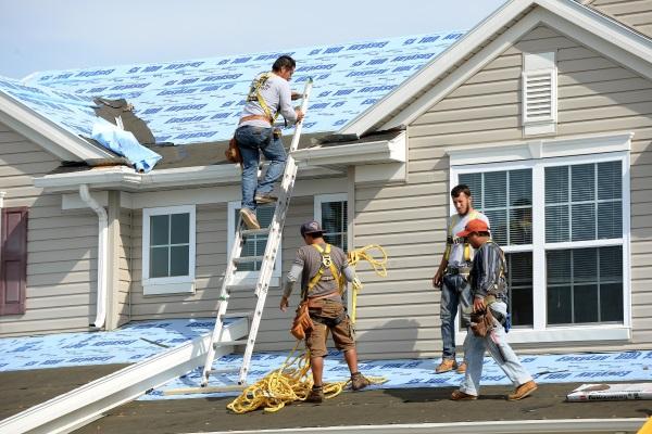 contractors performing a full roof restoration