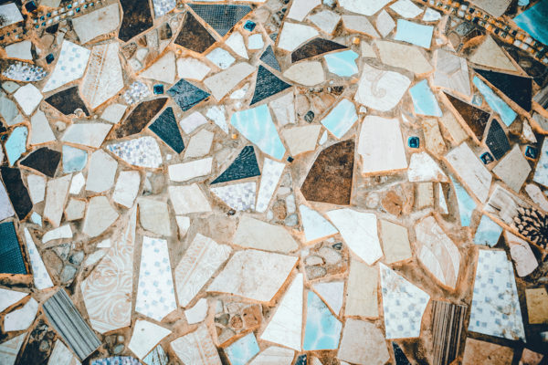 Close-up of neutral colored beige and turquoise abstract mosaic ceramic tiles