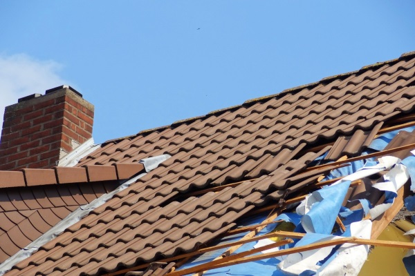 severely damaged clay tile roof