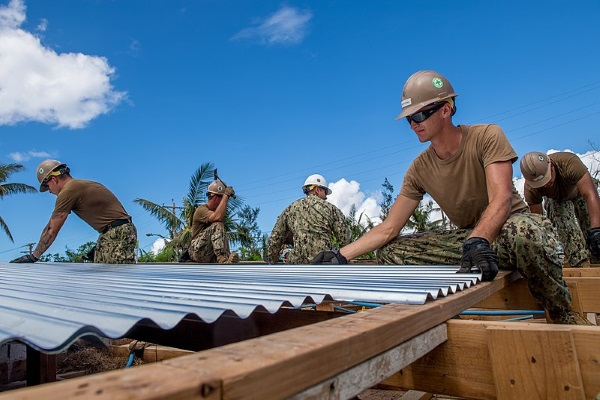 contractors installing corrugated metal roofing